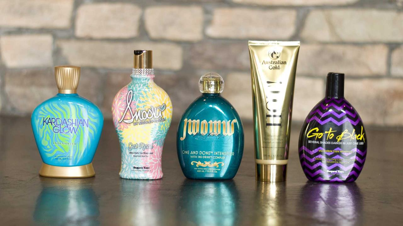 A lineup of high quality Accelerator Tanning Lotions with a stone wall in the background.