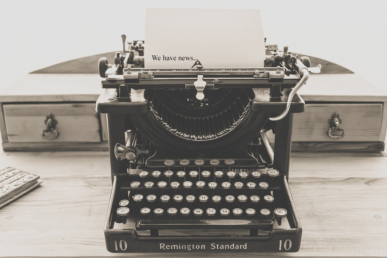 we have news written on paper in old typewriter