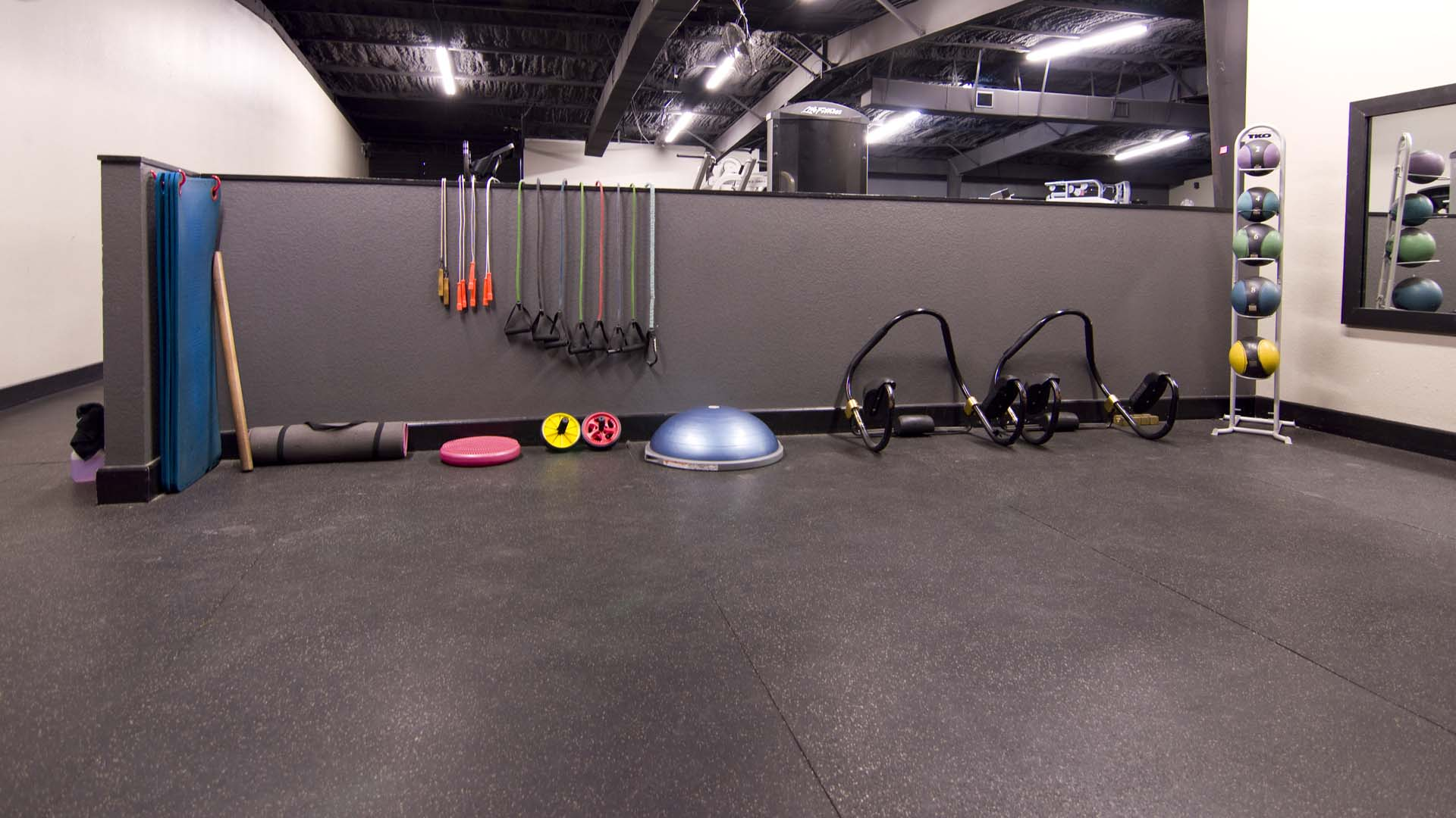 Fitness bands, medicine balls and a variety of other equipment in the core area of the gym.